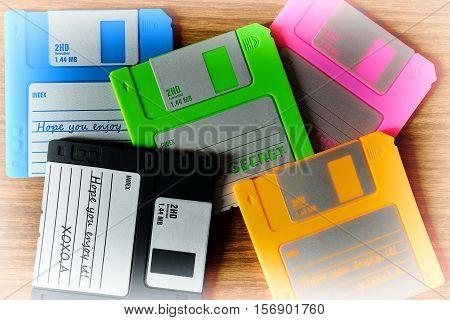 Vintage Set Of Floppy Discs On Wooden Desk Background
