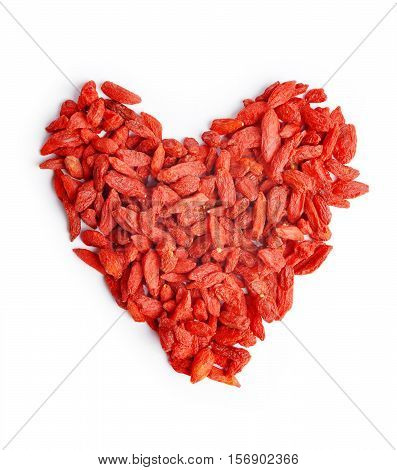 Heap in the shape heart of goji berries (Lycium barbarum) isolated on white background
