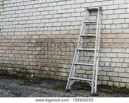 Old Ladder staircase against a brick background