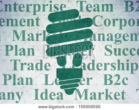 Finance concept: Painted green Energy Saving Lamp icon on Digital Data Paper background with  Tag Cloud