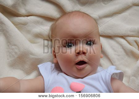 Suprised Baby With Big Eyes Photo. Beautiful Picture, Background, Wallpaper