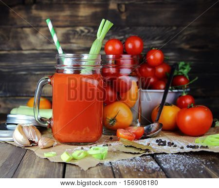 tomato juice in a mug with celery and straw