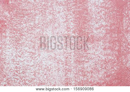 Closeup pale color and peeling of painted red cement wall textured background