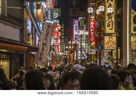 OSAKA, JAPAN - OCTOBER 9, 2016: Unidentified people on the street of Osaka Japan. Osaka is known for its modern architecture nightlife and hearty street food.