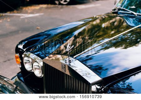PARIS FRANCE - SEP 12 2016; Luxury Rolls-Royce car limousine parked in city during fashion wedding vip event. Rolls-Royce Limited is a British car-manufacturing and later aero-engine manufacturing company founded by Charles Stewart Rolls and Sir Frederick