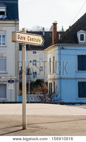 Gare Centrale - Central Train station street arrow street sign seen in central French town at major intersection with French architecture homes behind