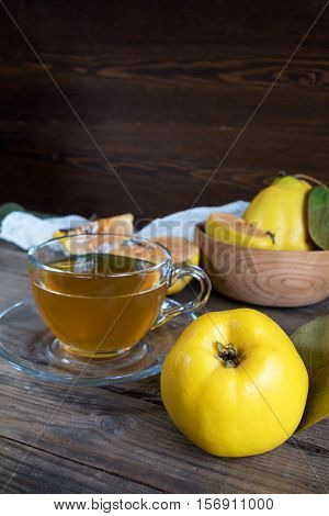 Cup Of Hot  Tea And Fresh Quince Fruit On Table