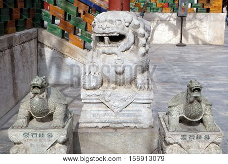 BEIJING - FEBRUARY 25: Lion and turtle statues in Yonghe Temple also known as Yonghe Lamasery or simply Lama Temple in Beijing, China, February 25, 2016.