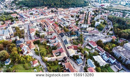 Aerial view of historical town of slovak town of Banska Bystrica surrounded by green nature. Streets of old town.
