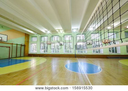 MOSCOW, RUSSIA - JUN 28, 2016: Modern gym with volleyball net in 2107 school, In Moscow there are more than 1800 schools