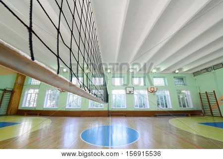 MOSCOW, RUSSIA - JUN 28, 2016: Empty gym with volleyball net in 2107 school, In Moscow there are more than 1800 schools