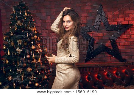 Self-confident Girl With Glass Of Champagne. Beautiful Girl In A Club Dancing And Smile. Christmas P