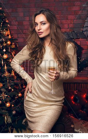 Beautiful Blond Girl With A Champagne On A Christmas Party Dancing And Smile. Lovely Girl In A Beaut