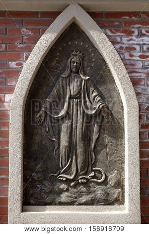 SHANGHAI - FEBRUARY 28: Blessed Virgin Mary, the outer wall of the cathedral of St. Ignatius in Shanghai, China, February 28, 2016.