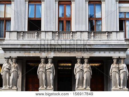 Balcony with caryatids in the Austrian Parliament Building view from Rathausplatz in Vienna poster