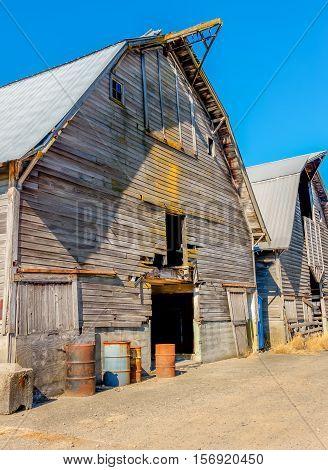 A view of an old weatherbeatn barn in Auburn Washington. HDR image.