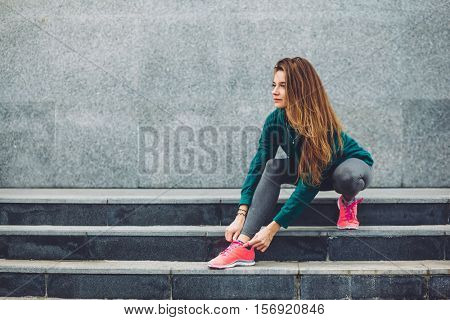 Fitness sport girl in fashion sportswear doing yoga fitness exercise in the street, outdoor sports, urban style poster