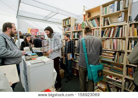 PRAGUE, CHECHIA - MAY 16, 2014: Happy students choose books at the indoor second hand market on May 16, 2014 in Czech Republic. Fourteenth-largest city in the European Union Prague is home to 1.3 million people