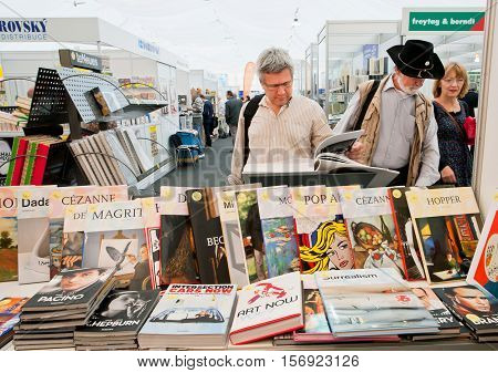 PRAGUE, CHECHIA - MAY 16, 2014: Many people choose art and photo books at the indoor book market on May 16, 2014 in Czech Republic. Fourteenth-largest city in the European Union Prague is home to 1.3 million people