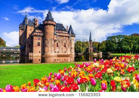 Beautiful medieval castle Da Haar and blooming tulips. Holland
