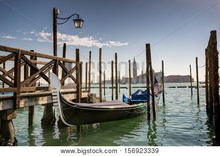 Gondola in Venice and San Giorgio Maggiore island on the background