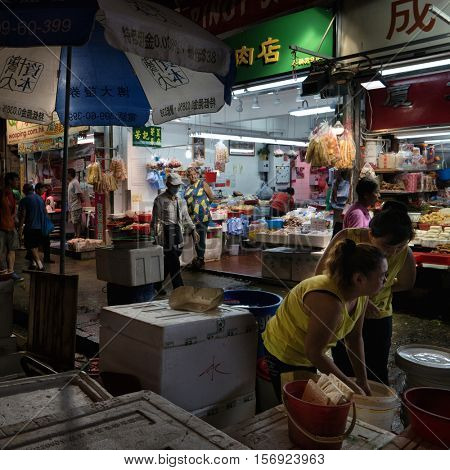 HONG KONG - October 2016: Evening view of wet market with people.