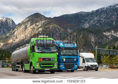 E45 Motorway, Austria - October 21, 2016: Trucks parked in a parking lot in the Alps. Trucks for various purposes and duty.