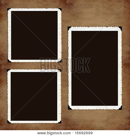 Blank photograph holders on old grungy paper