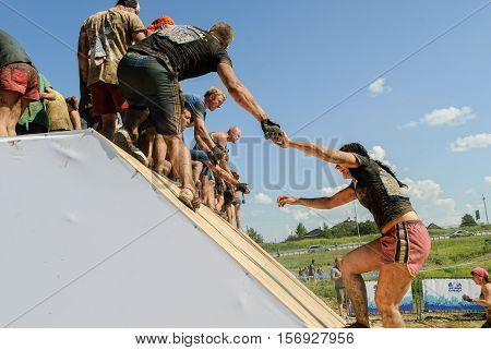 Tyumen, Russia - July 9, 2016: Steel Character extrim race on Voronino Hill. Girl runs on inclined wall