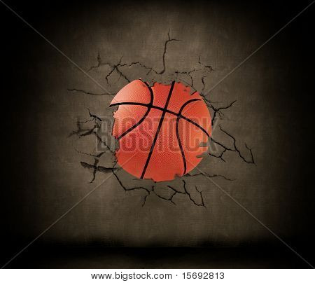 A basketball wedged into a concrete wall