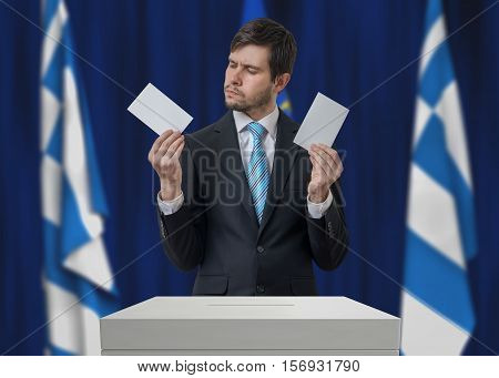 Election In Greece. Undecided Voter Is Making Decision.