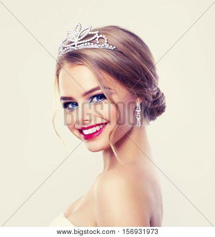 Beautiful Woman Fashion Model in Diamonds Diadem and Earrings