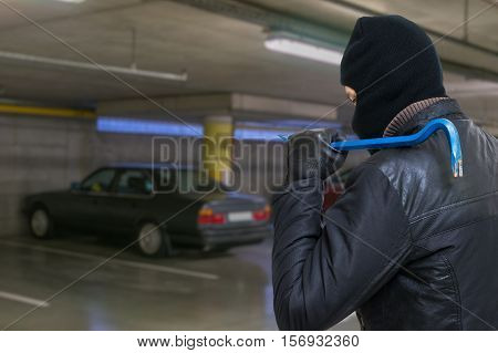 Thief With Crowbar Is Going To Steal Car From Garage.