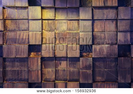 Geometric pattern of wooden elements. Decorating the walls of wooden bars.