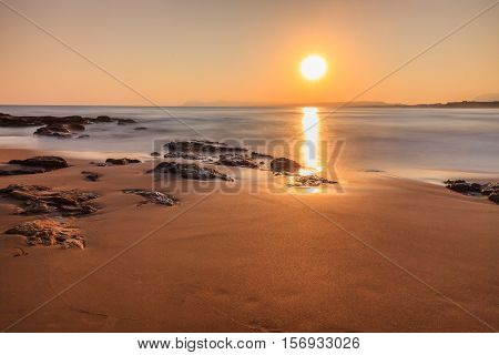 sunrise on the beach in Crete island Greece