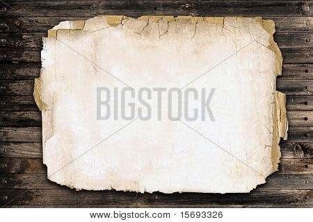 Old paper on a wood fence, room for copy