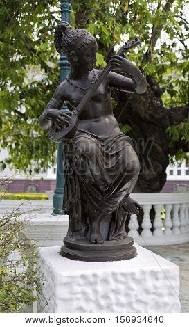 AYUTTHAYA, THAILAND - November 4, 2016: Statue at Bang Pa-In Palace the summer palace of the Thai king in Ayutthaya Thailand