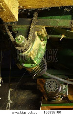 Electric motors chain drive sawmill wood industry theme.