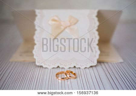 Wedding rings on a white background infinity sign of the rings wedding rings and invitation card