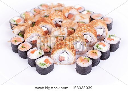 Japanese food restaurant, sushi maki gunkan roll plate or platter set. California Sushi rolls with salmon. Sushi isolated at white background. Top view, flat lay.