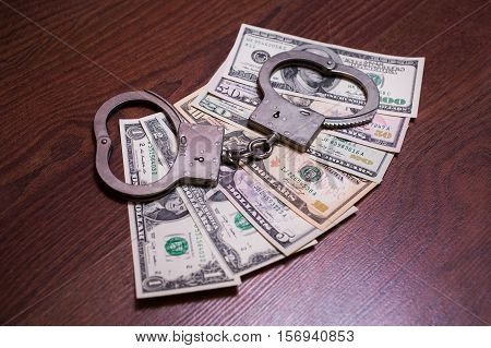 one two five ten twenty fifty and one hundred dollar bills and handcuffs