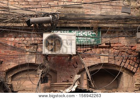 KOLKATA, INDIA - FEBRUARY 07: The chaos of cables and wires in Kolkata. Uncovered optical fiber technology open air outdoors in Asian cities, on February 07, 2016 in Kolkata, India