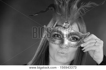 Woman Holding Carnival Mask Closeup