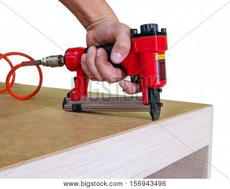 Stapler gun protective gloves on wood board construction concept.