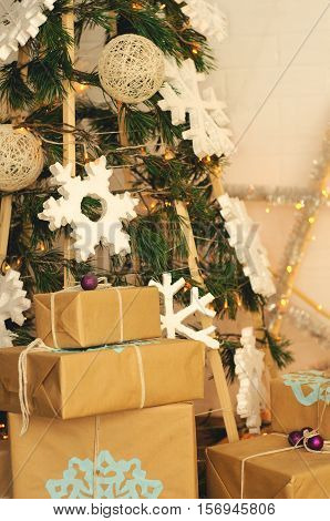 Christmas photo zone in vintage style with hand-made Christmas tree