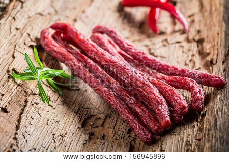 Homemade Thin Sausages In Rural Storeroom On Bark