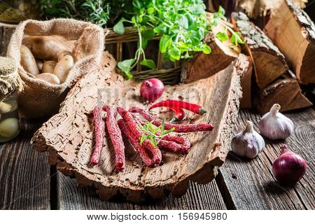 Homemade Kabanos Sausages In Rural Storeroom On Bark