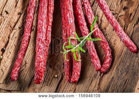 Fresh Kabanos Sausages In Rural Storeroom On Bark