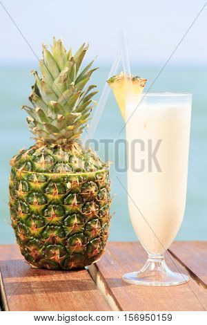 Pina Colada Cocktail With Pine Apple At The Sea Pier. Concept Of Luxury Vacation. Beach Party