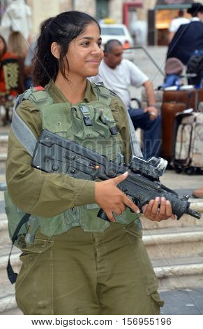 JERUSALEM ISRAEL 28 10 2105: Portrait of Israel Defense Forces women downtowm Jerusalem, commonly known in Israel by the Hebrew acronym Tzahal are the military forces of the State of Israel.